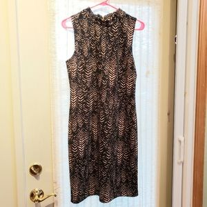Animal print dress knee length. Mock neck. Back zi